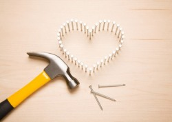 Heart-shape, hammer and nails